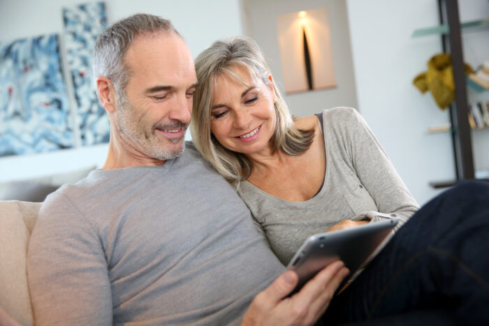 A mature couple planning their retirement income