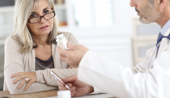 A senior woman consulting her doctor